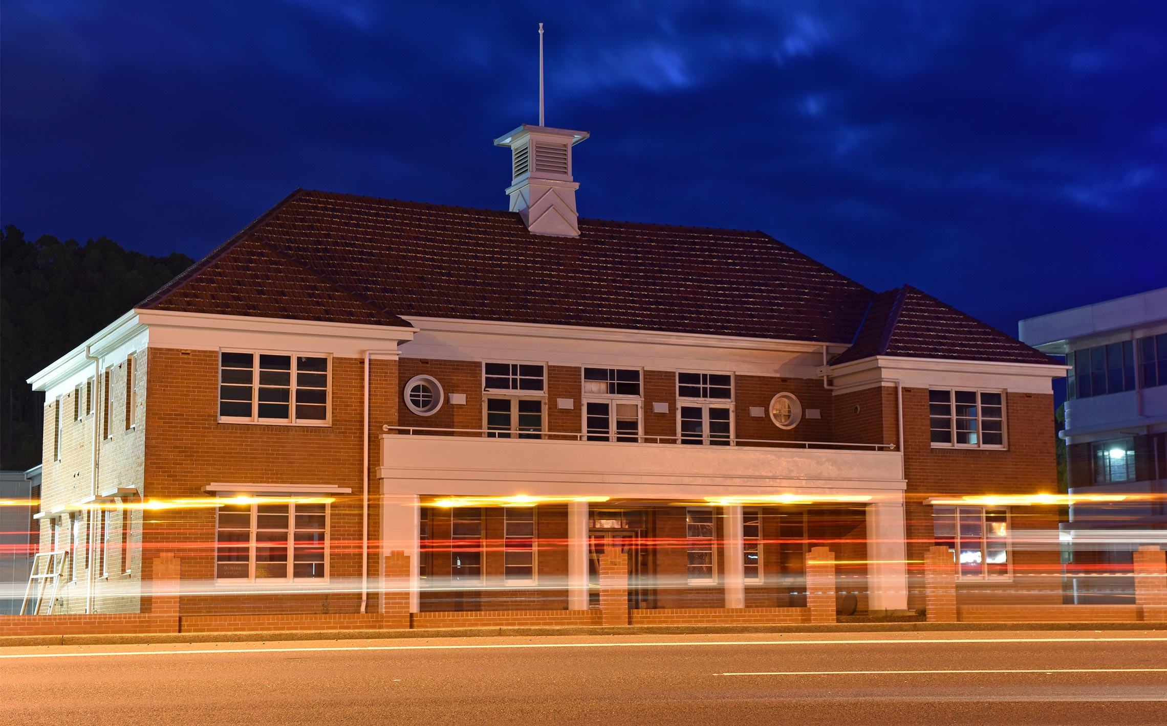 Restored paper mill office building in Burnie, Tasmania with blurred lights.