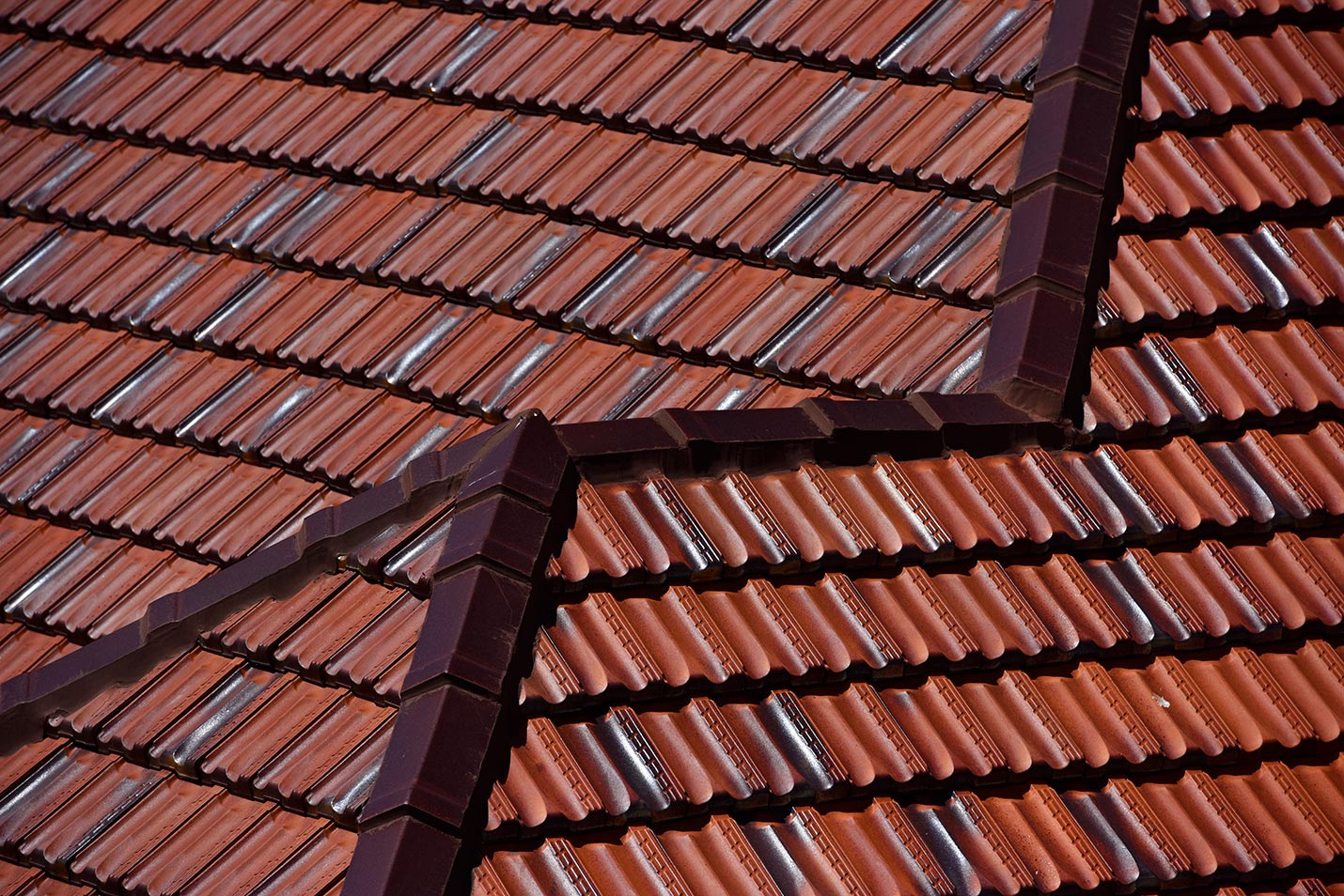 Close up view of the tile re-roof featuring Monier Terracotta tiles - Marseille in Aurora Gold.